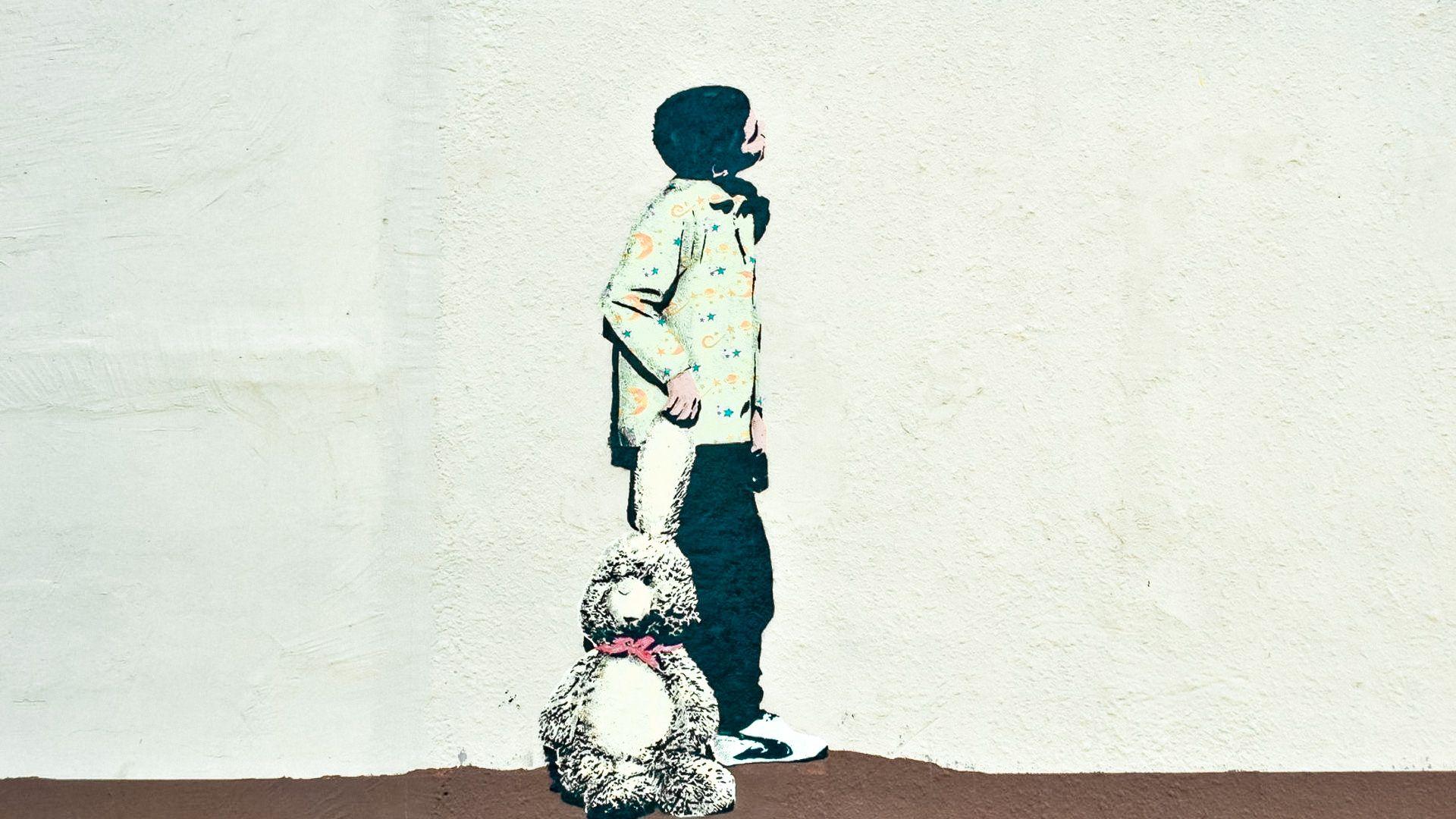 """Grafitis """"Laimingi vaikai = vaikai tarp mūsų"""""""
